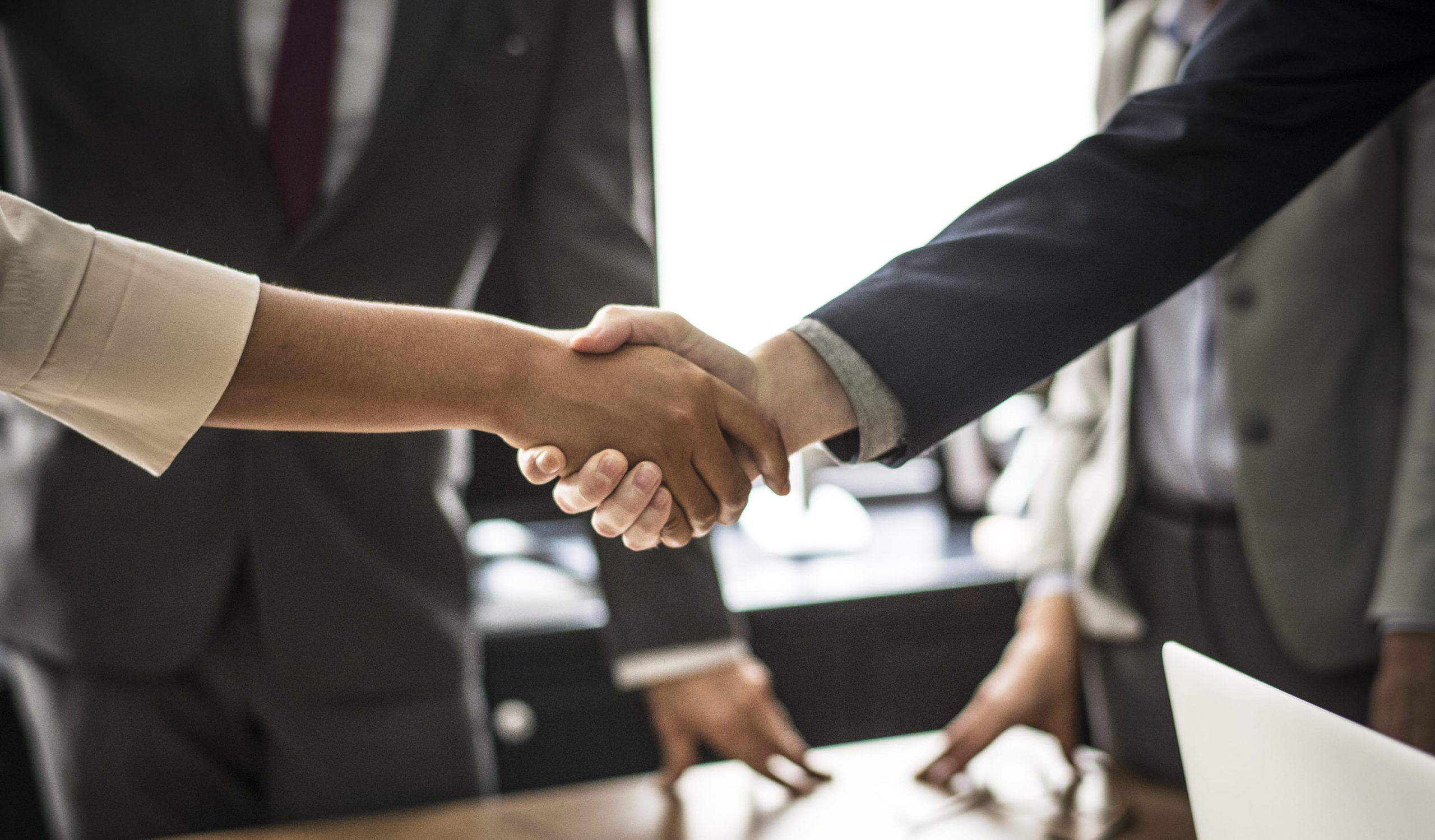 Conflict resolution - Business people shaking hands
