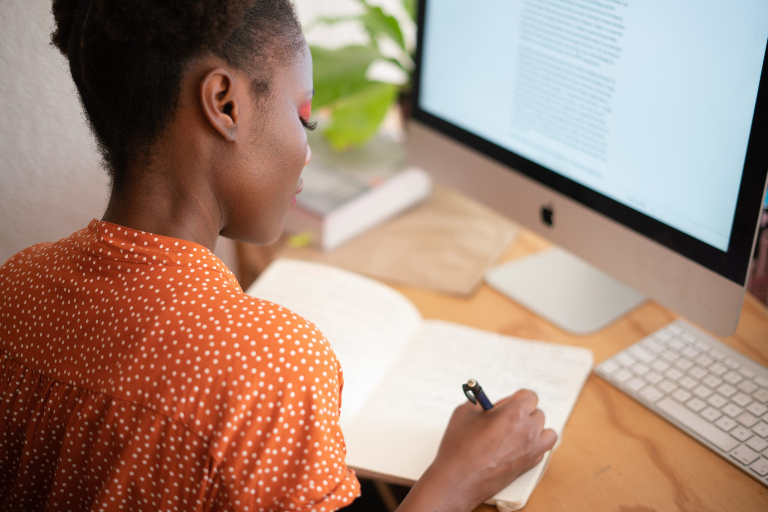 Woman writing personal strengths Directions Coaching
